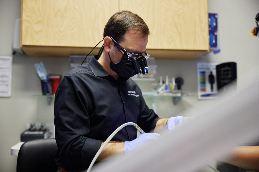 Dr. Chahine performing an impacted wisdom teeth removal at Just Smiles in Westerville.