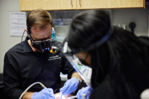 Hilliard OH dentist Dr. Phil Chahine performing a routine teeth cleaning for a Columbus patient.