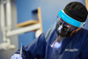 Hilliard OH dentist performing a bone graft during oral surgery.